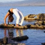 Silhouette of girl doing yoga — Stock Photo #5646968