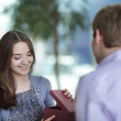 Young man gives a present to his girl — Stock Photo #5646986