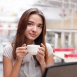 Beautiful girl drinking coffee — Stock Photo #5646999