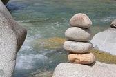 Beach stones with water — Stock Photo