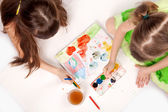 Little girl paint on floor — Stock Photo