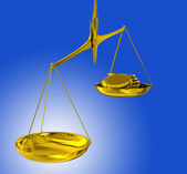 Golden coin on balance — Stockfoto