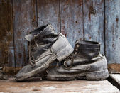 Old farmer shoes — Stock Photo