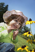 Baby on flower lawn — Stock Photo