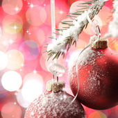 Christmas balls in snow — Stockfoto