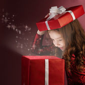 Litle girl open red gift box — Stock Photo