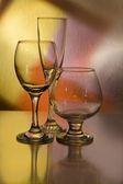 Cognac glass on vintage background — Stock Photo