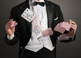 Magician juggle card — Stock Photo