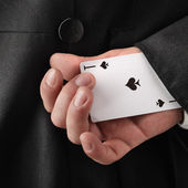 Magician hiding card — Stock Photo