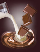 Chocolate heart and milk — Stock Photo