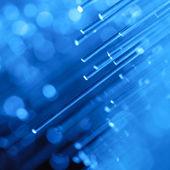Optics fibers on blue background — Stock Photo
