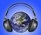 Headphones & earth — Stock Photo