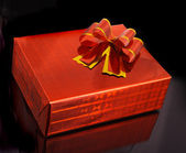 Red gift box isolated on black background — Stock Photo