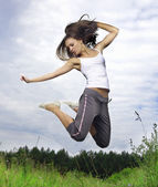 Happy jumping girl — Stockfoto