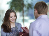 Young man gives a present to his girl — Stock Photo