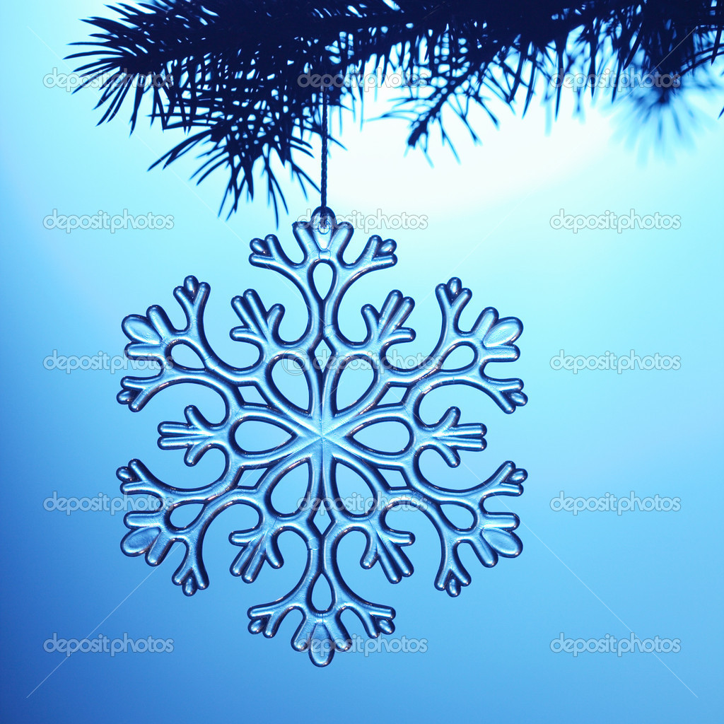 Silvery snowflake on blue background  Stock Photo #5644036