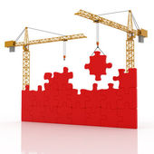 Two cranes and construction puzzle — Stock Photo
