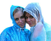 Two girls in raincoats — Stock Photo