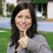 Girl wiht thumb up — Stock Photo