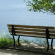 Empty bench on the lake — Stock Photo