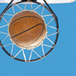 Stock Photo: Basketball in net against clear blue skies