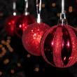 Red Christmas ornaments hanging in a row — Stock Photo