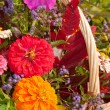 Close up image of brilliantly colored flowers in a wicker basket — Stock Photo