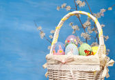 Colorful Easter basket filled with hand painted eggs — Stock Photo