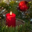 Christmas candle with a wreath — Stock Photo