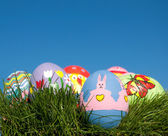 Hand painted Easter eggs in grass — Stock Photo