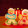 Two Christmas cookies holding hands — Stock Photo