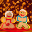Two funny, colorful Christmas cookies shaped like a girl and a boy — Stock Photo