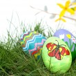 Stock Photo: Colorful hand painted Easter eggs in green spring grass