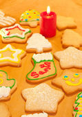 Colorful Christmas cookies on a wooden table — Stock Photo