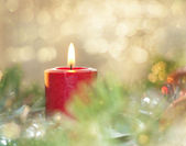 Dreamy image of a Christmas candle burning — Stock Photo
