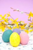 Closeup image of pastel colored hand painted Easter eggs — Stock Photo