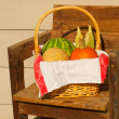 Stock Photo: Produce in wicker basked lined with classic old linen towel