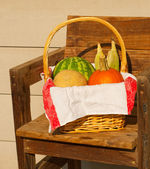 Produce in a wicker basked lined with a classic old linen towel — Stock Photo