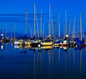 Anchored Yacht and Boats — Stock Photo