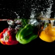 Red, Yellow, Green Pepper Splash — Stock Photo
