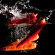 Chillies and Carrots Water Splash — Stock Photo #5906680