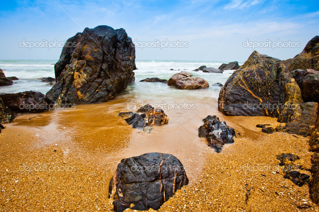 Waves, breaking on rocks at a beach in Malaysia — Stock Photo #6477751
