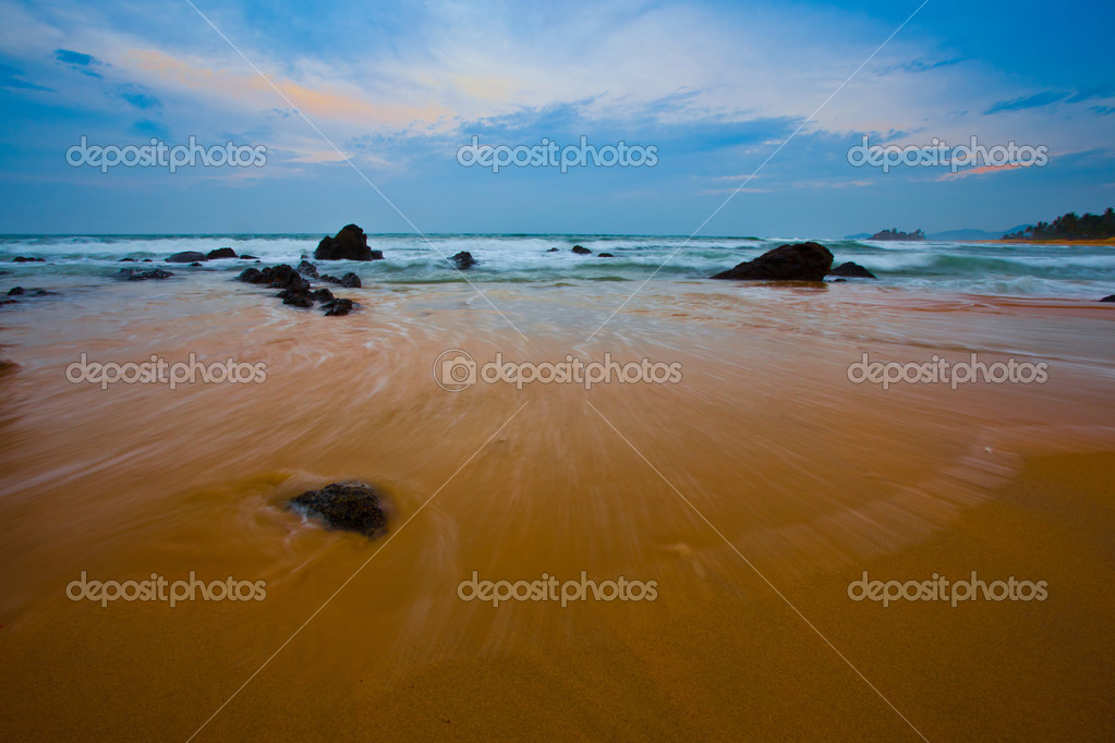 Waves, breaking on rocks at a beach in Malaysia  Stock Photo #6477953