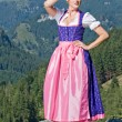 Bavarian girl on the mountain top - Stock Photo