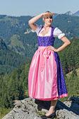 Bavarian girl on the mountain top — Stock Photo