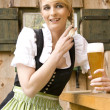 Young woman in the beer garden - Stock Photo