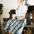 Stock Photo: Bavarian beauty on a bench