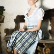 Bavarian beauty on a bench - Stock Photo
