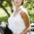 Young woman on motorcycle - Stock Photo