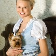 Young Bavarian beauty with dog — Stock Photo